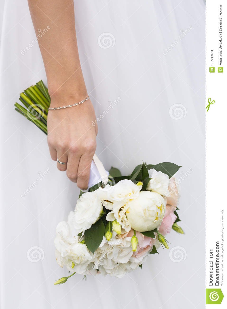 Wedding Bouquet Of Flowers White And Pink Roses In Hand Of Bride
