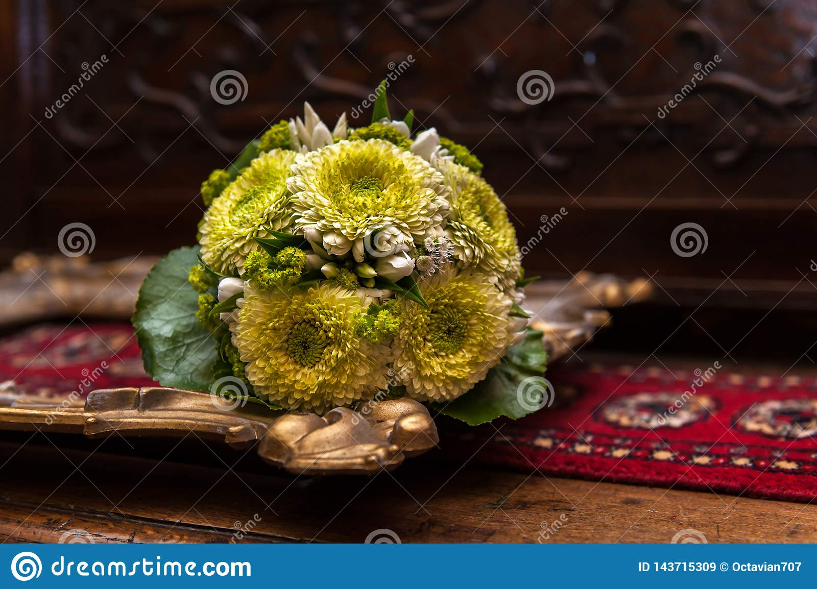 Wedding bouquet on a golden picture frame