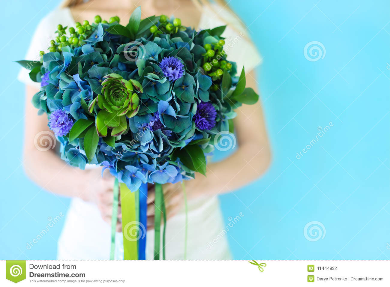 a wedding bouquet with hydrangea in blue and green colors