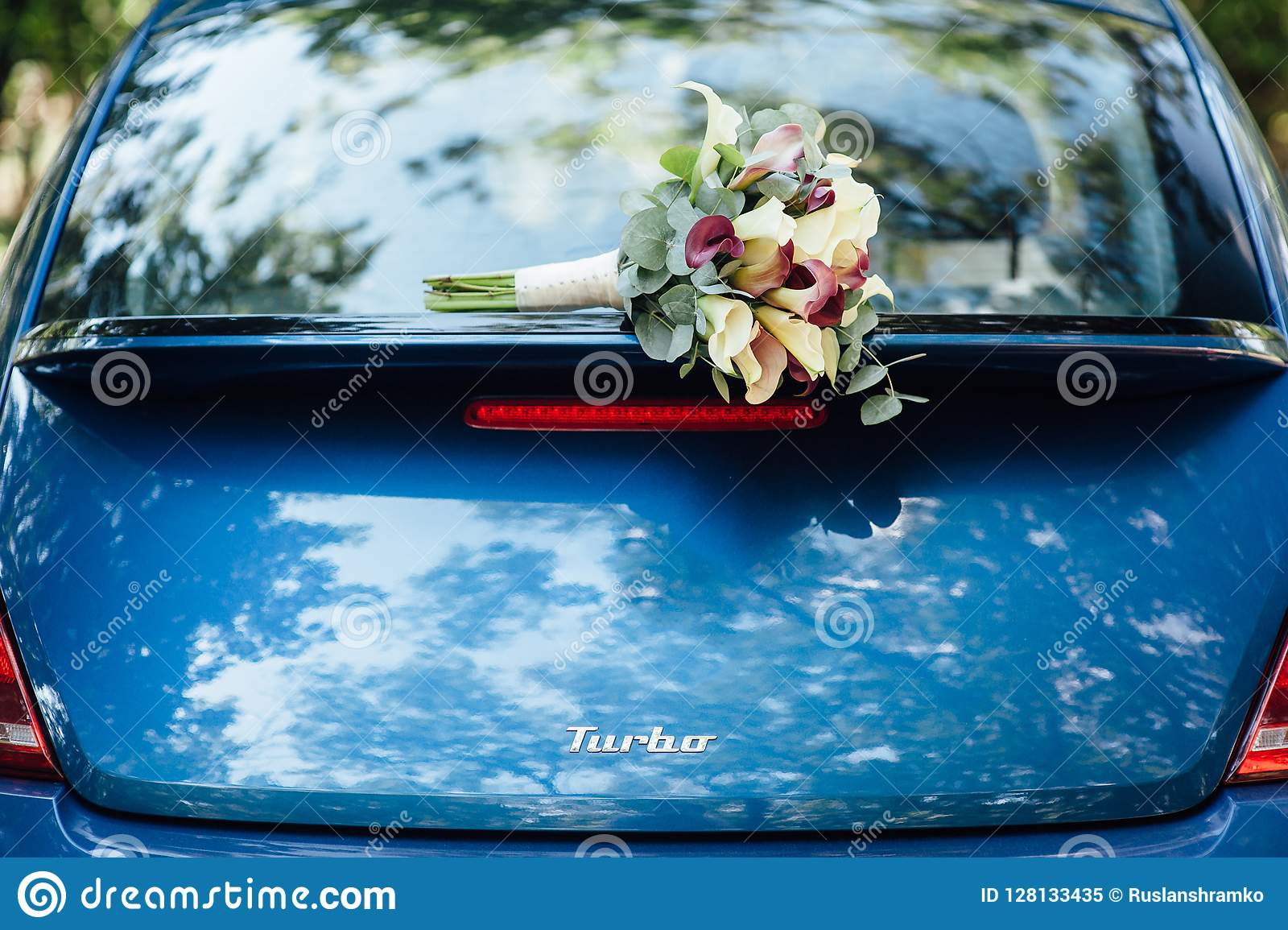 A Wedding Bouquet Lies On A Beautiful Blue Car Wedding