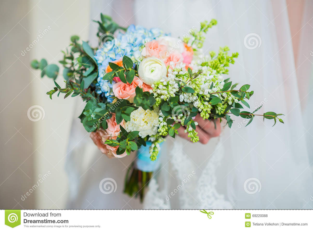 Wedding bouquet made of roses peonys hortensia stock for How are blue roses made