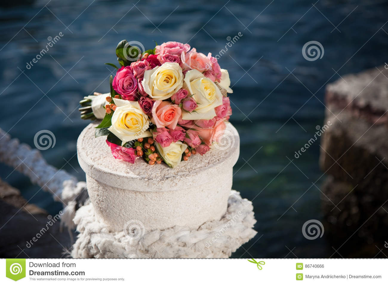 Wedding Bouquet Of Pink And Cream Roses Near Blue Sea Stock Photo