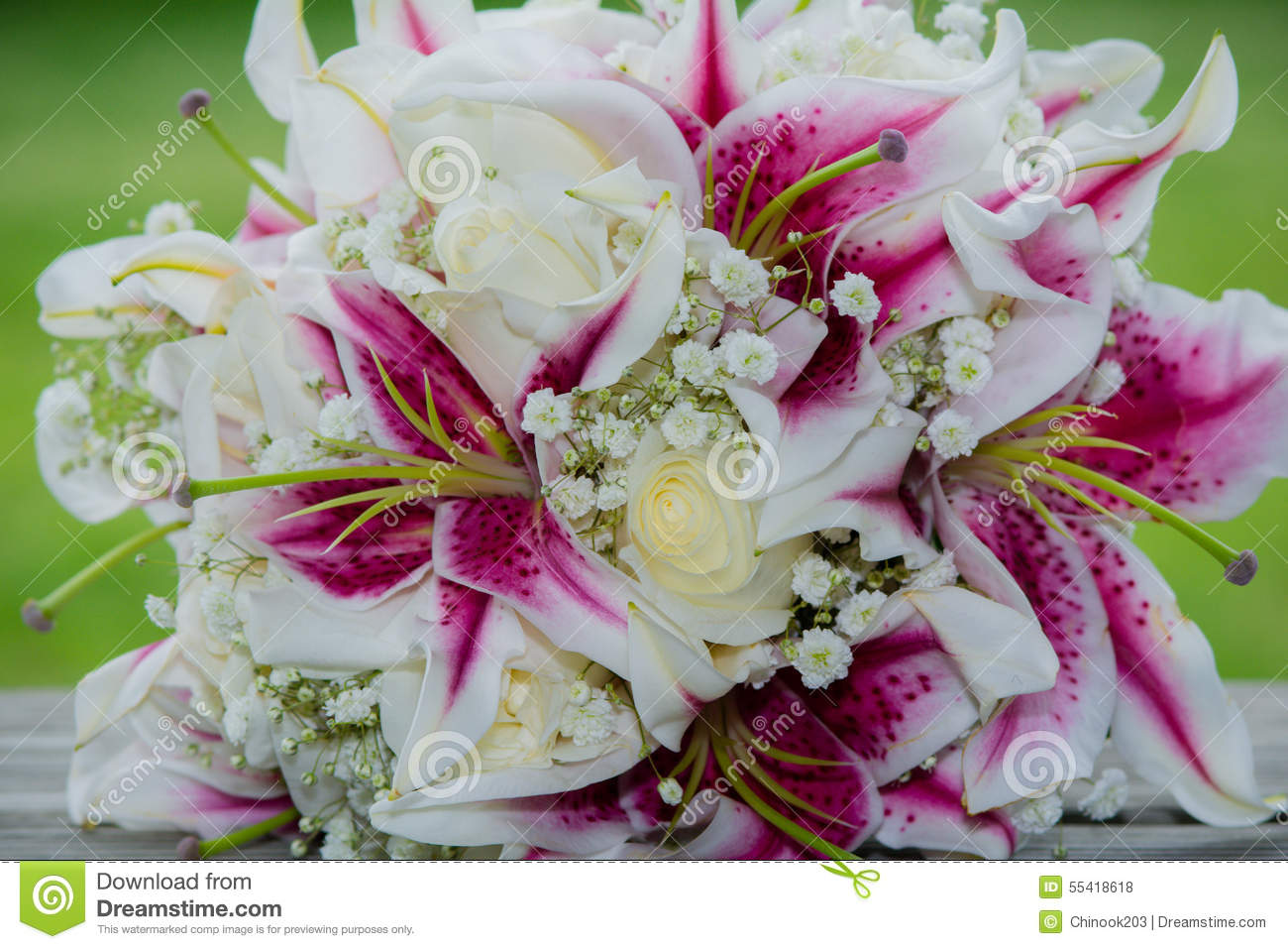 Wedding Bouquet Of Pink Fuchsia Flowers Stock Photo Image Of Boots