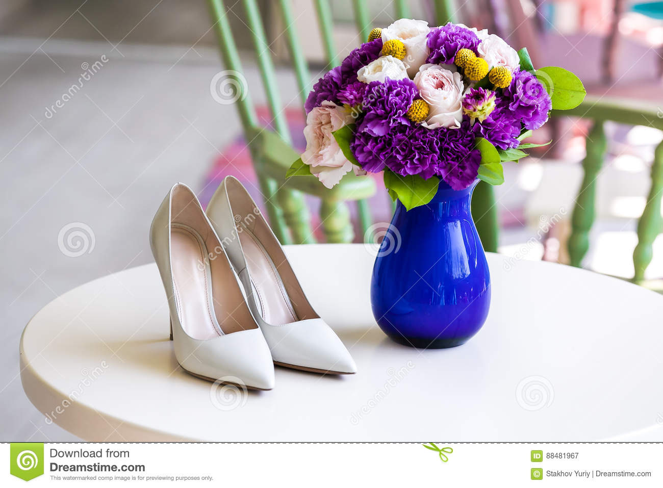 Wedding Bouquet Of Pink And Purple Flowers And Shoes Stock Image