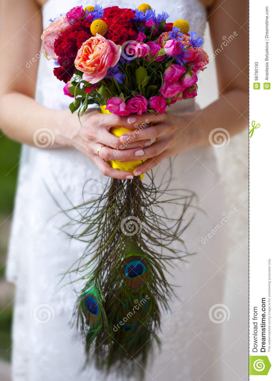 Wedding Bouquet Of Pink Red Blue And Yellow Flowers And Hand Of