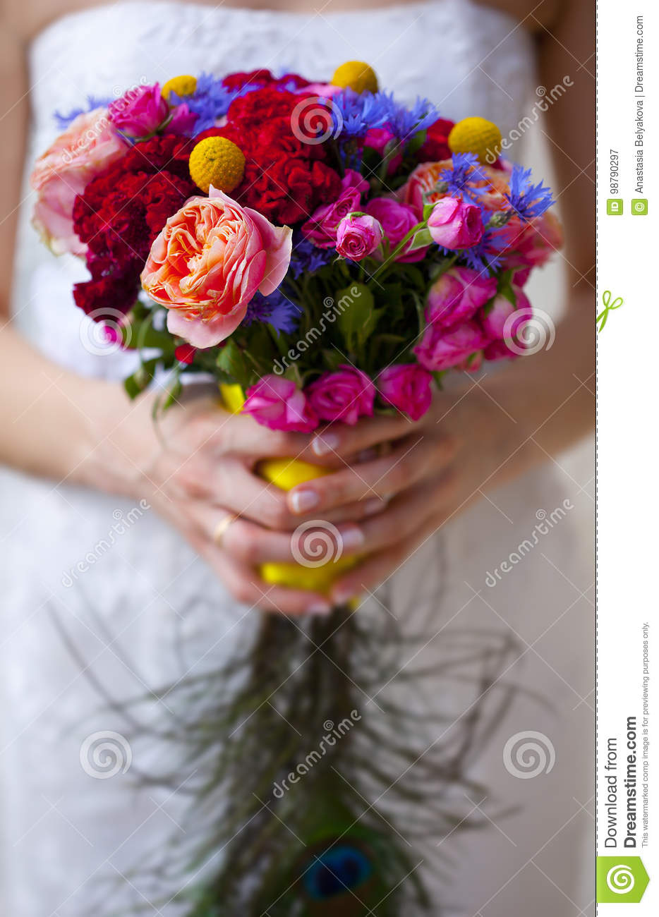 Wedding bouquet of pink red blue and yellow flowers and hand of download wedding bouquet of pink red blue and yellow flowers and hand of bride izmirmasajfo