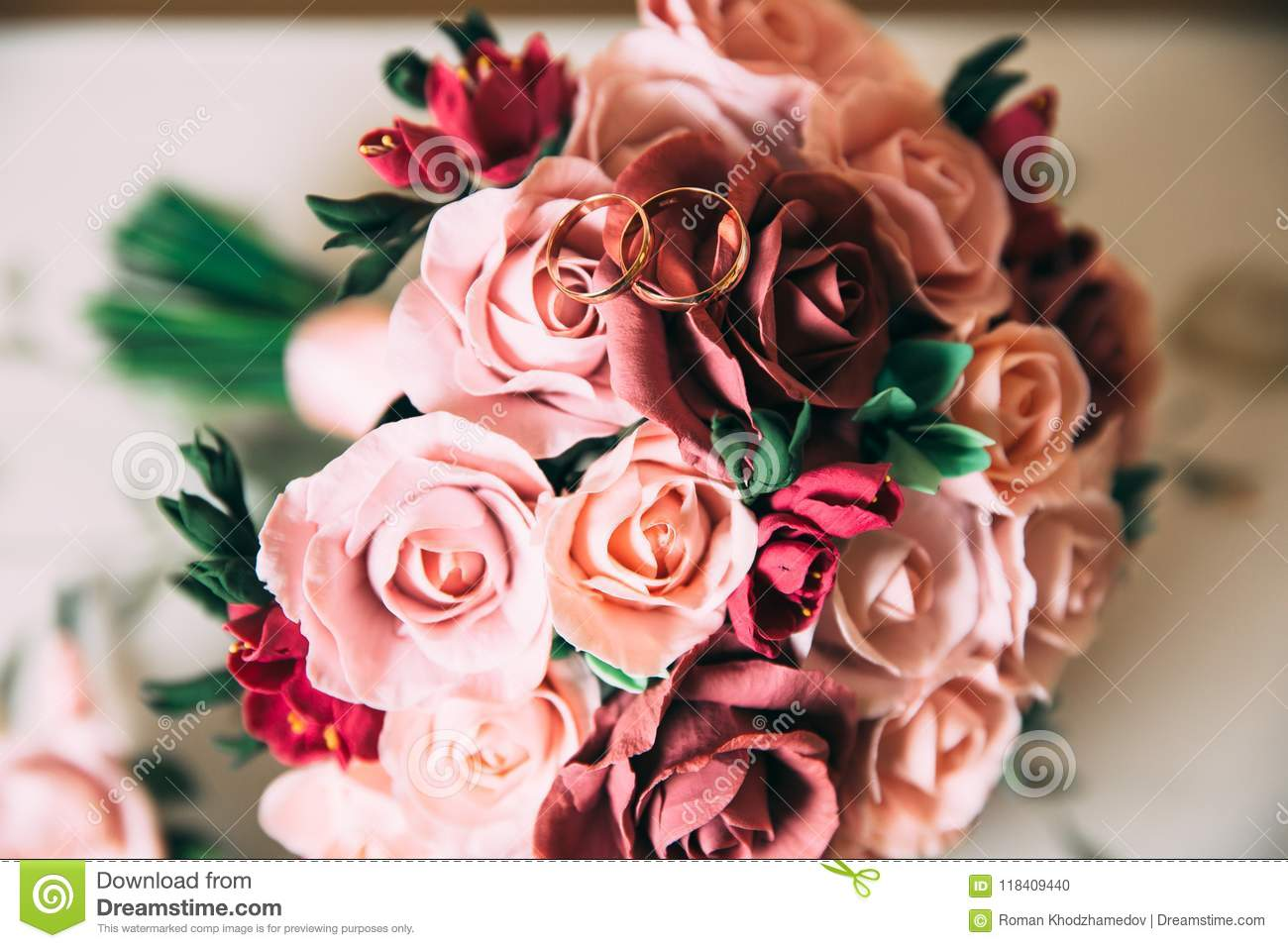 A Wedding Bouquet Of Red And Pink Roses Lies On A Wooden Vintage