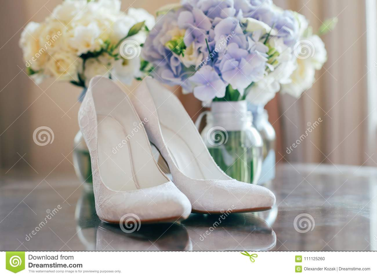 Wedding bouquet, rings and shoes