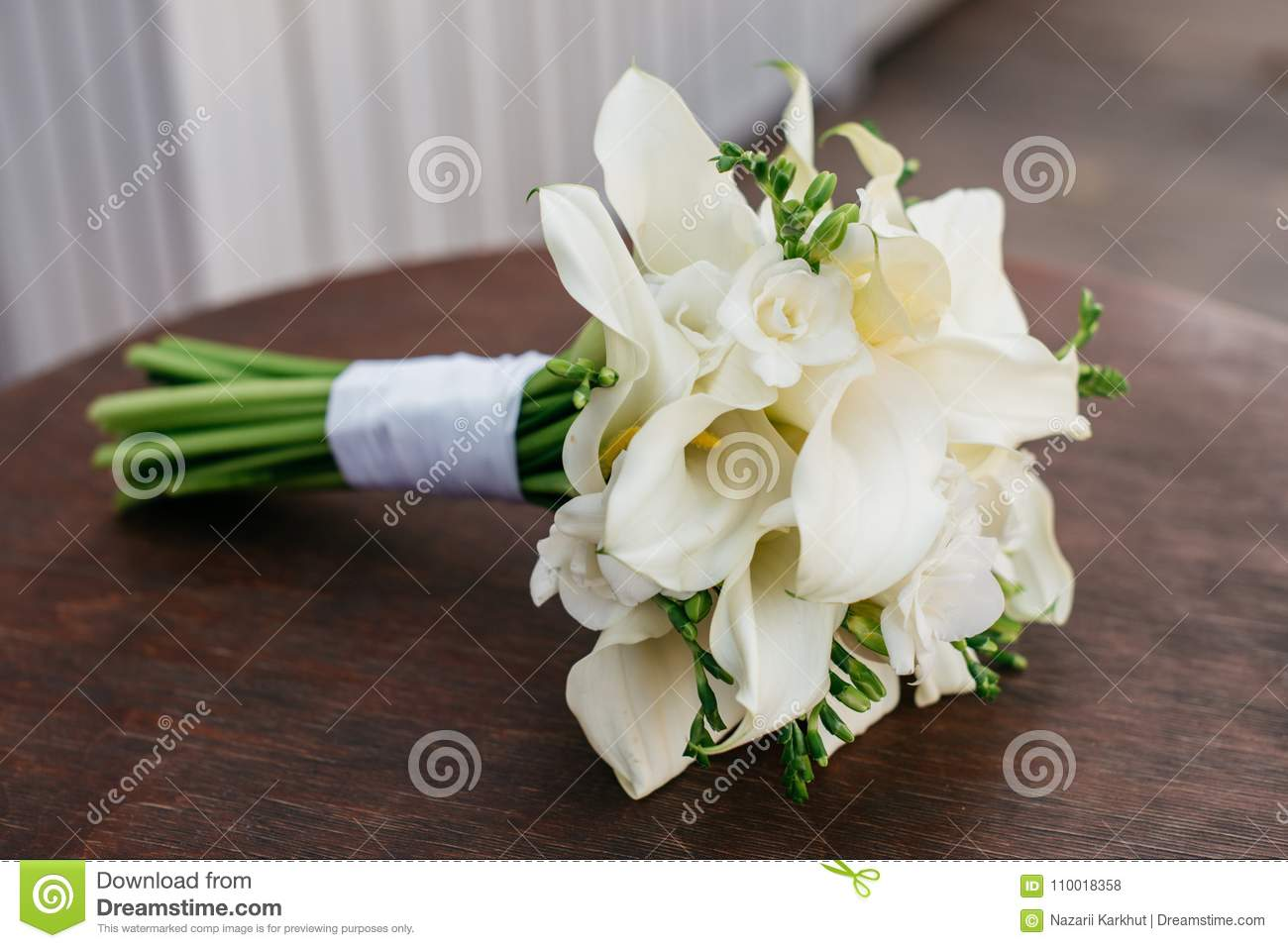 A Wedding Bouquet Of White Flowers Lies On A Round Table Stock Photo