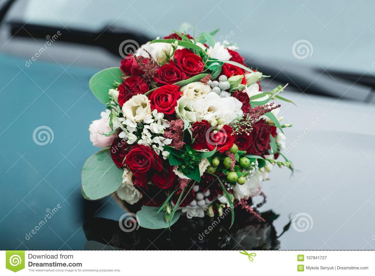 Wedding Bouquet Of White And Red Roses On A Car Hood Stock Image