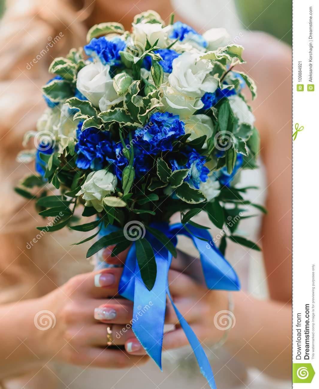 Wedding bouquet with white roses and blue flowers in the hands of wedding bouquet with white roses and blue flowers in the hands of the bride with a izmirmasajfo