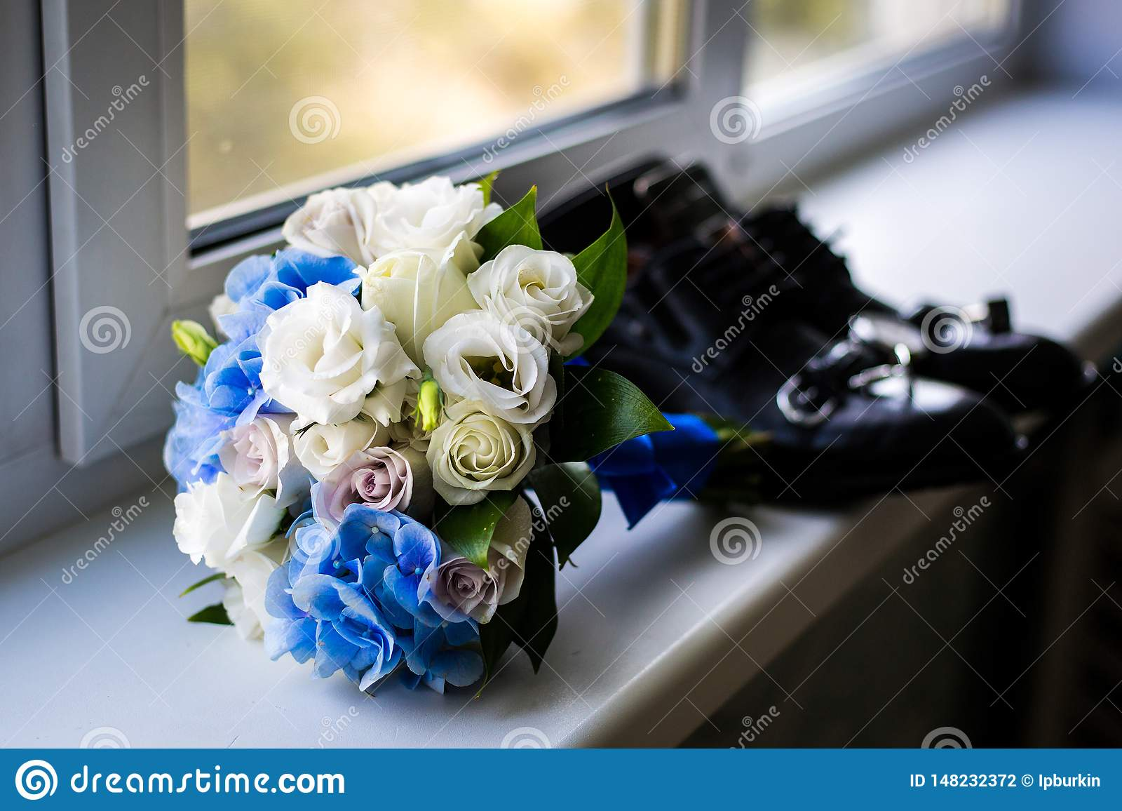 Wedding bouquet by the window.the attributes of the groom. newly married couple. the preparations of the groom
