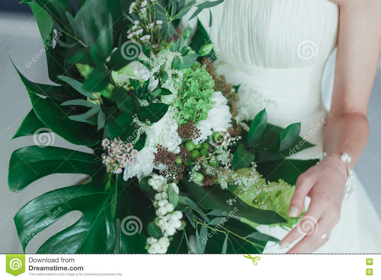 Wedding Bridal Bouquet With Big Tropical Green Leaves And White