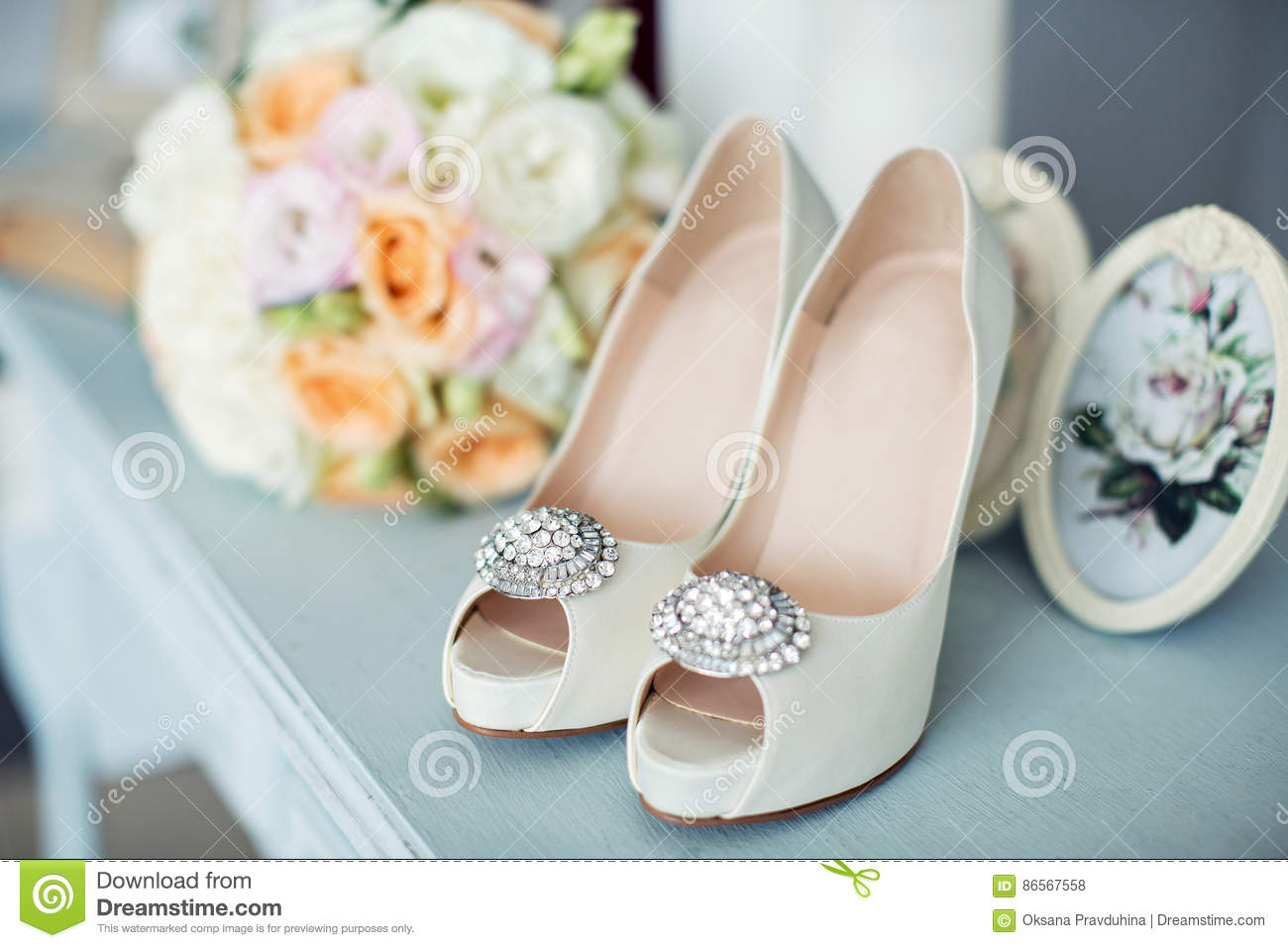 3d7ca68b745a7 Bridal bouquet and the bride`s shoes Morning