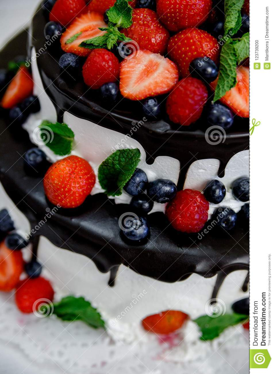 Wedding Cake With Berries In Chocolate Stock Photo Image Of
