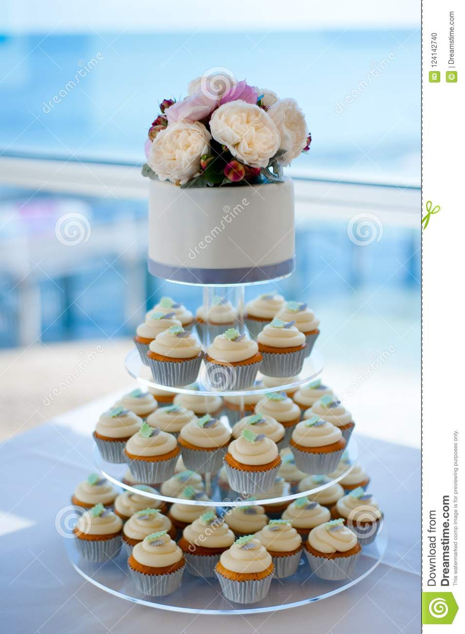 Wedding Cake With Cupcakes And Roses Stock Photo Image Of Tier Decoration 124142740