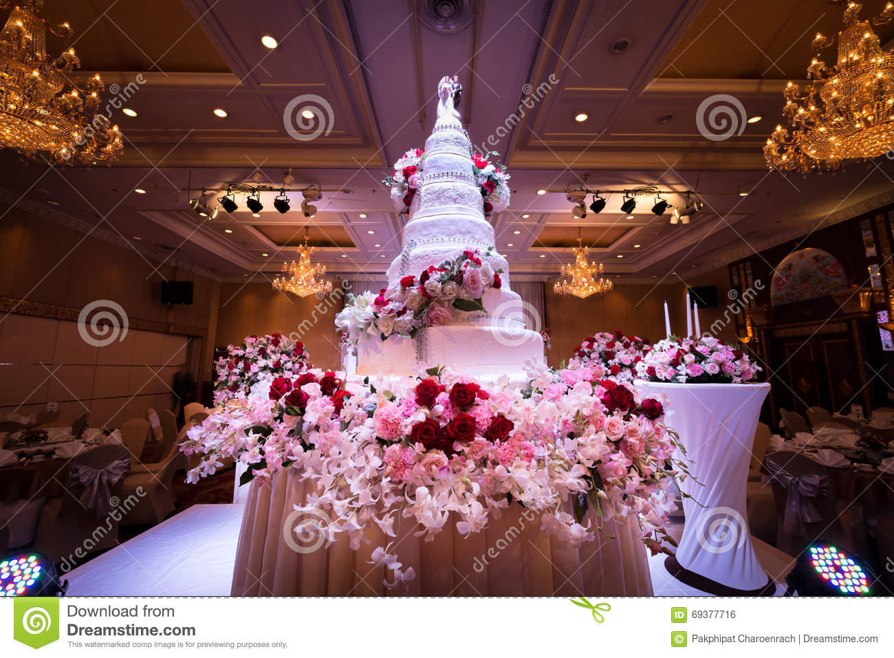 Wedding cake flowers decorations chandelier ceiling stock photos wedding cake and flowers decorations with chandelier on ceiling wedding cake and flowers decorations with arubaitofo Image collections