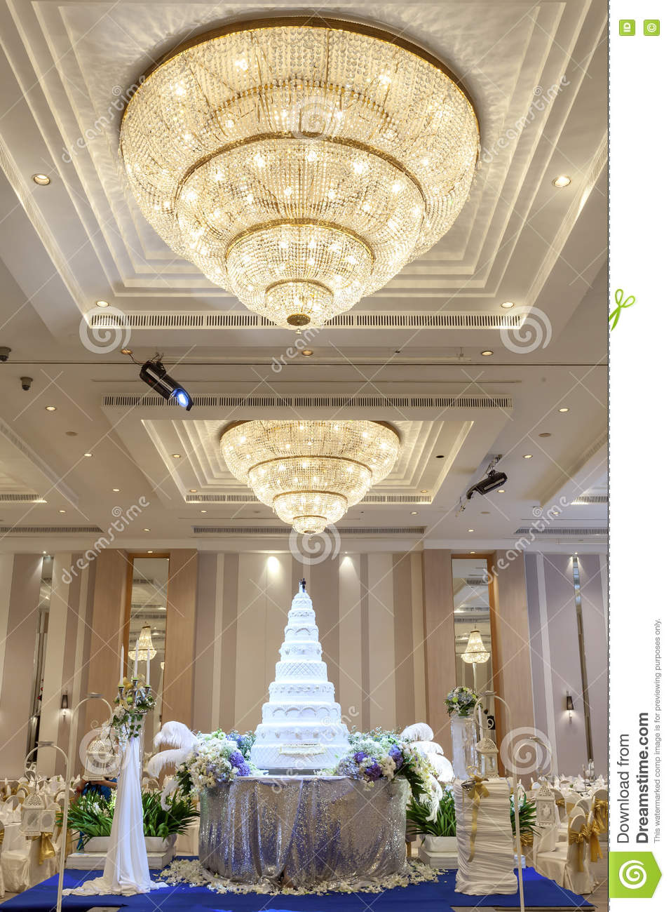Wedding Cake And Flowers Decorations With Chandelier On