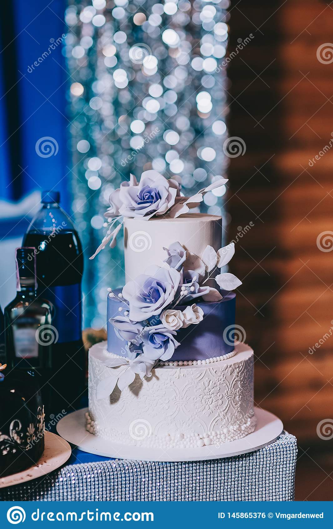 Wedding cake with flowers yellow beige red turquoise blue