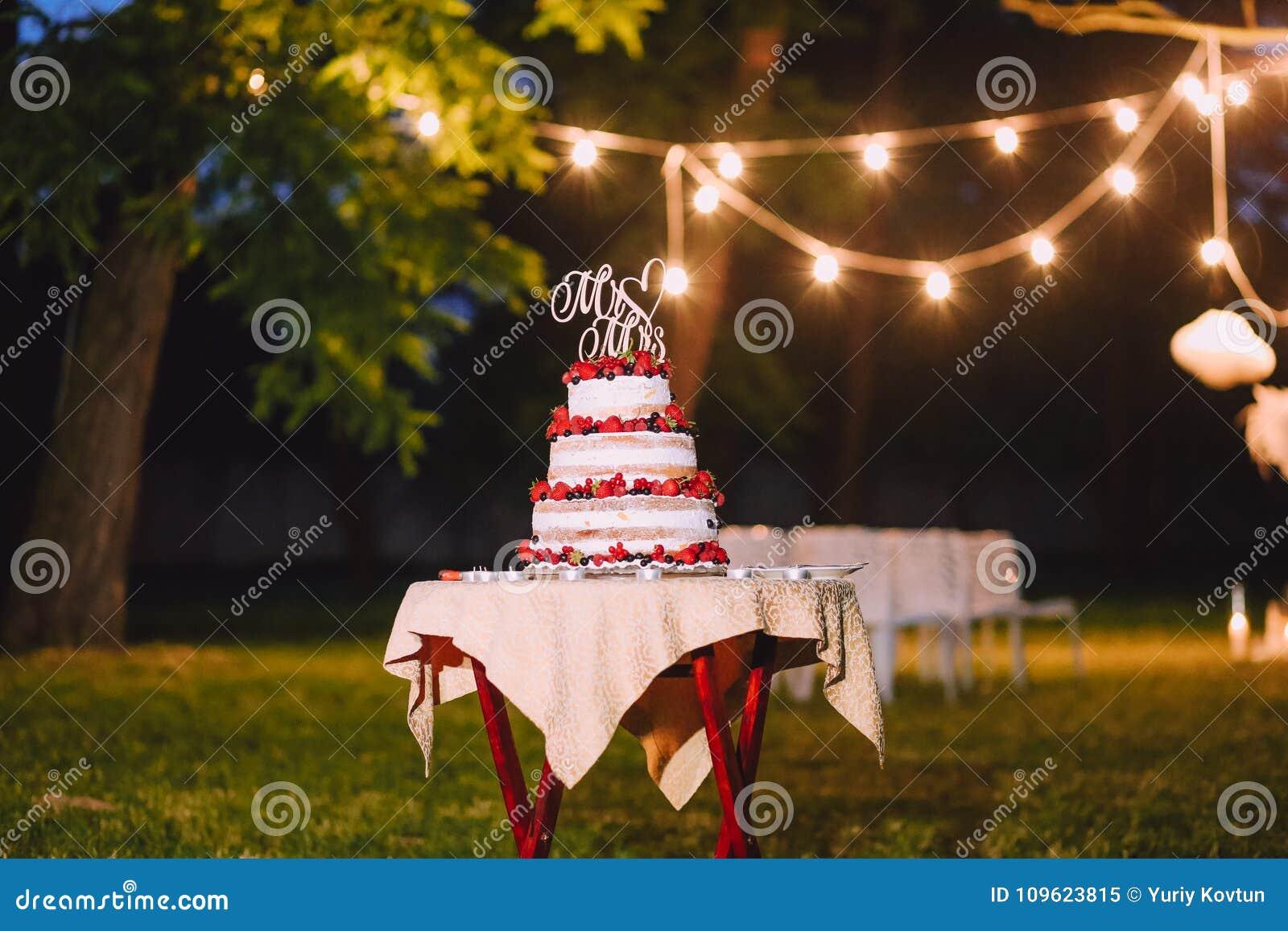 Wedding cake outside evening letters Mr Mrs