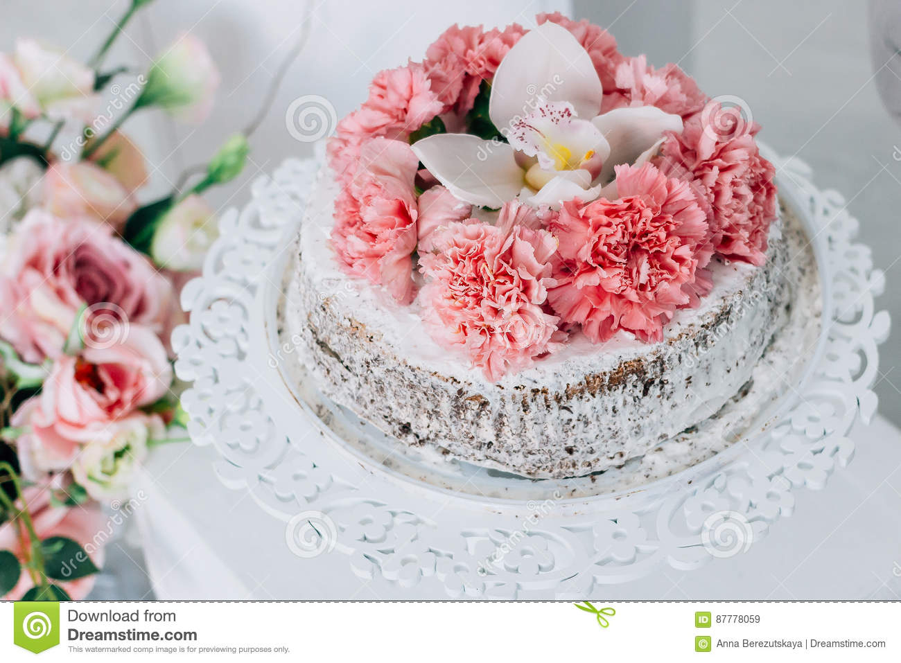 Wedding Cake On A White Pedestal Decorated With Fresh Flowers Stock ...