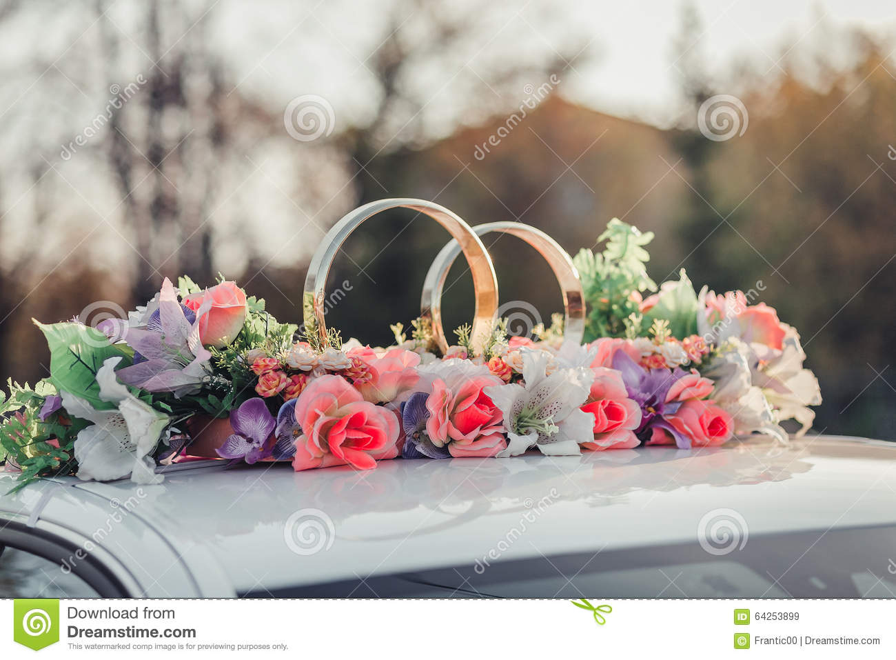 Wedding car decoration with flowers and golden rings stock image download comp junglespirit Choice Image