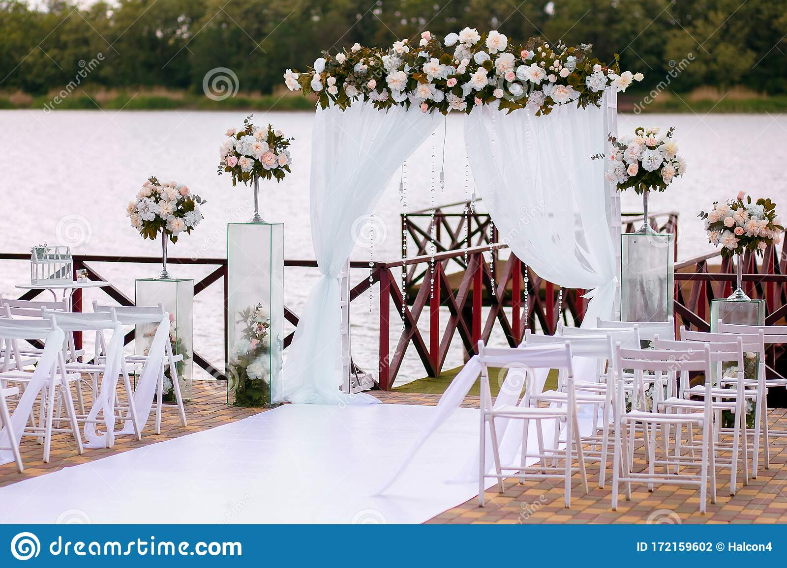 Wedding Ceremony Wedding Arch On The Background Of The River Beautiful Decoration With Flowers Stock Photo Image Of Bride Holiday 172159602