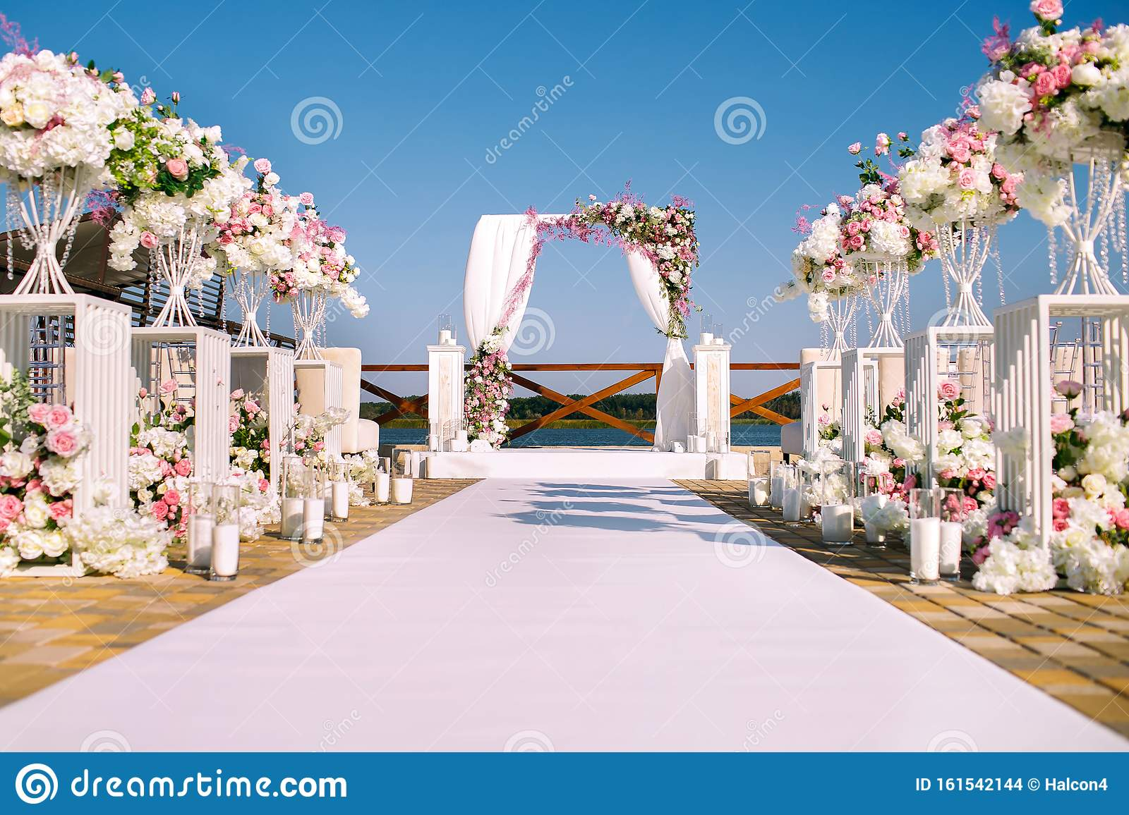 Wedding Ceremony Wedding Arch Wedding Arch Made Of Branches Flowers And Greenery Is On The Green Grass On The River Bank Stock Photo Image Of Bank Holiday 161542144