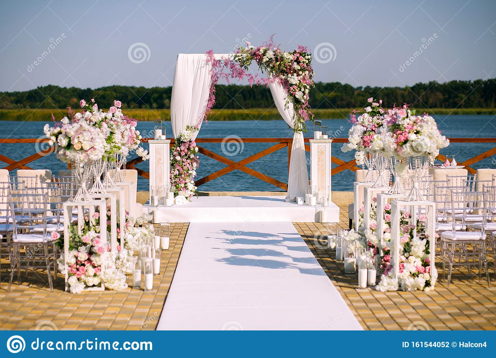 Wedding Ceremony Wedding Arch Wedding Arch Made Of Branches Flowers And Greenery Is On The Green Grass On The River Bank Stock Photo Image Of Arrangement Candles 161544052