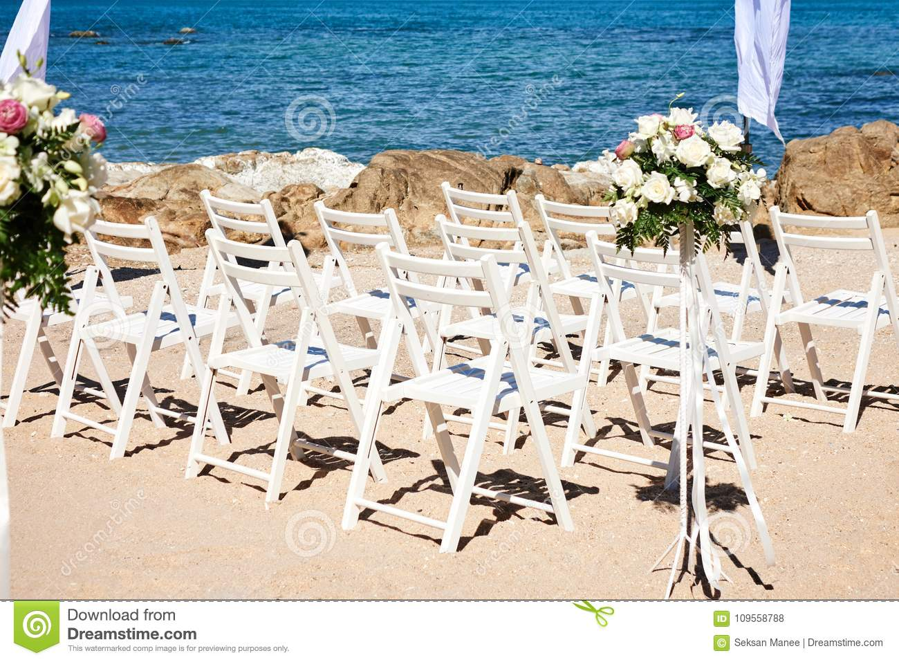 Remarkable Wedding Chairs White On The Sand Flowers Floral Decorated Download Free Architecture Designs Sospemadebymaigaardcom