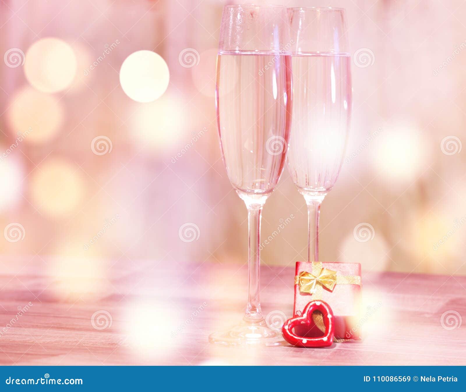 Wedding champagne glasses, romantic heart background