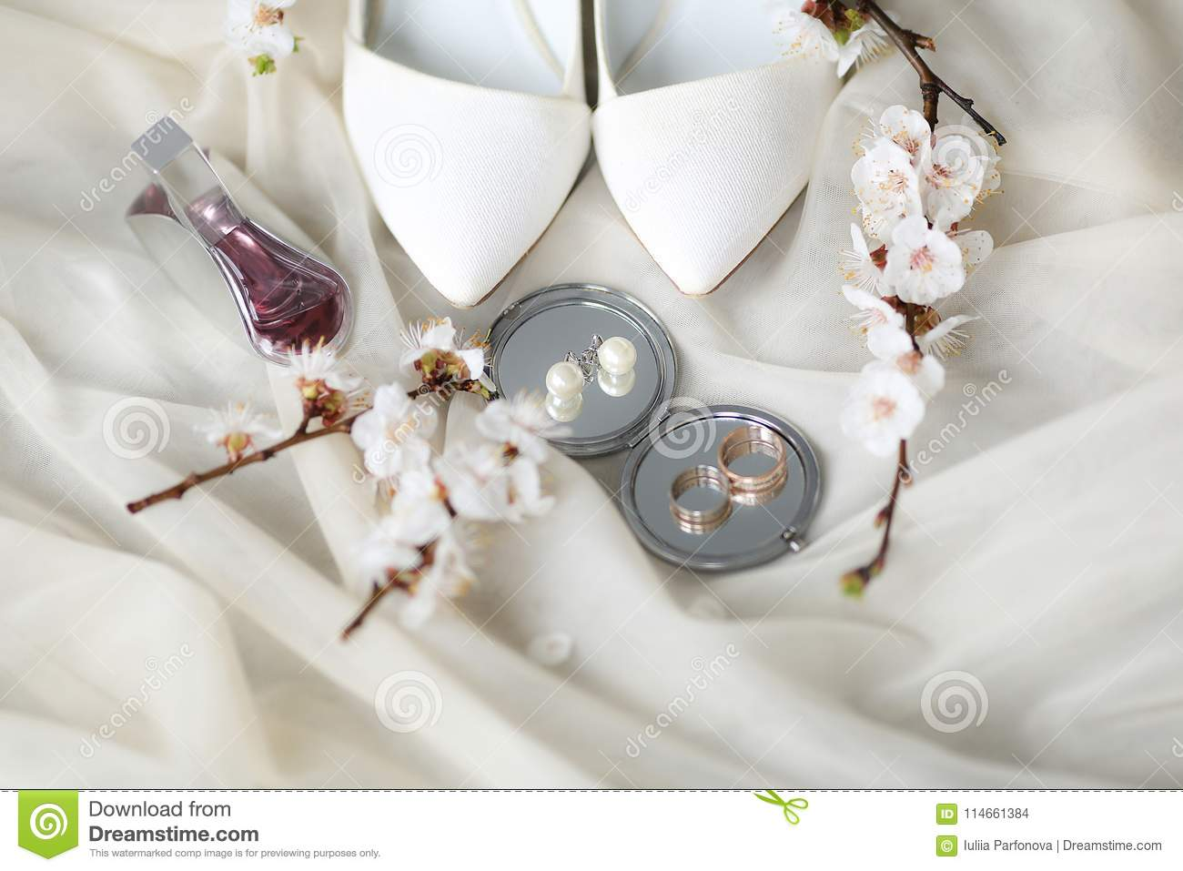 Wedding Rings And Shoes On Wedding Morning Of The Bride Stock
