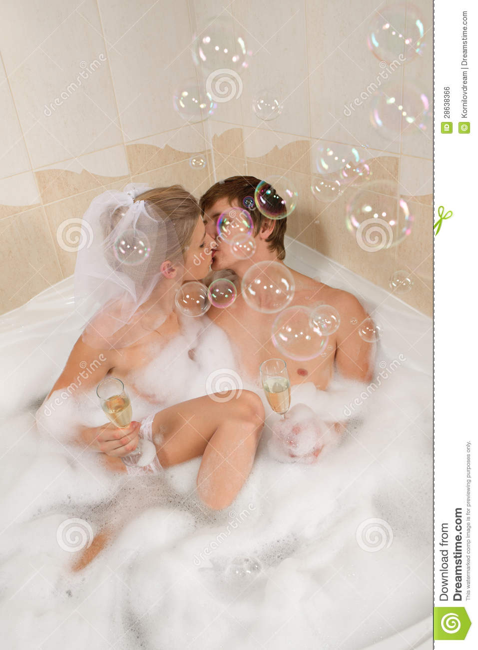 Wedding Couple Is Enjoying A Bath With Bubbles