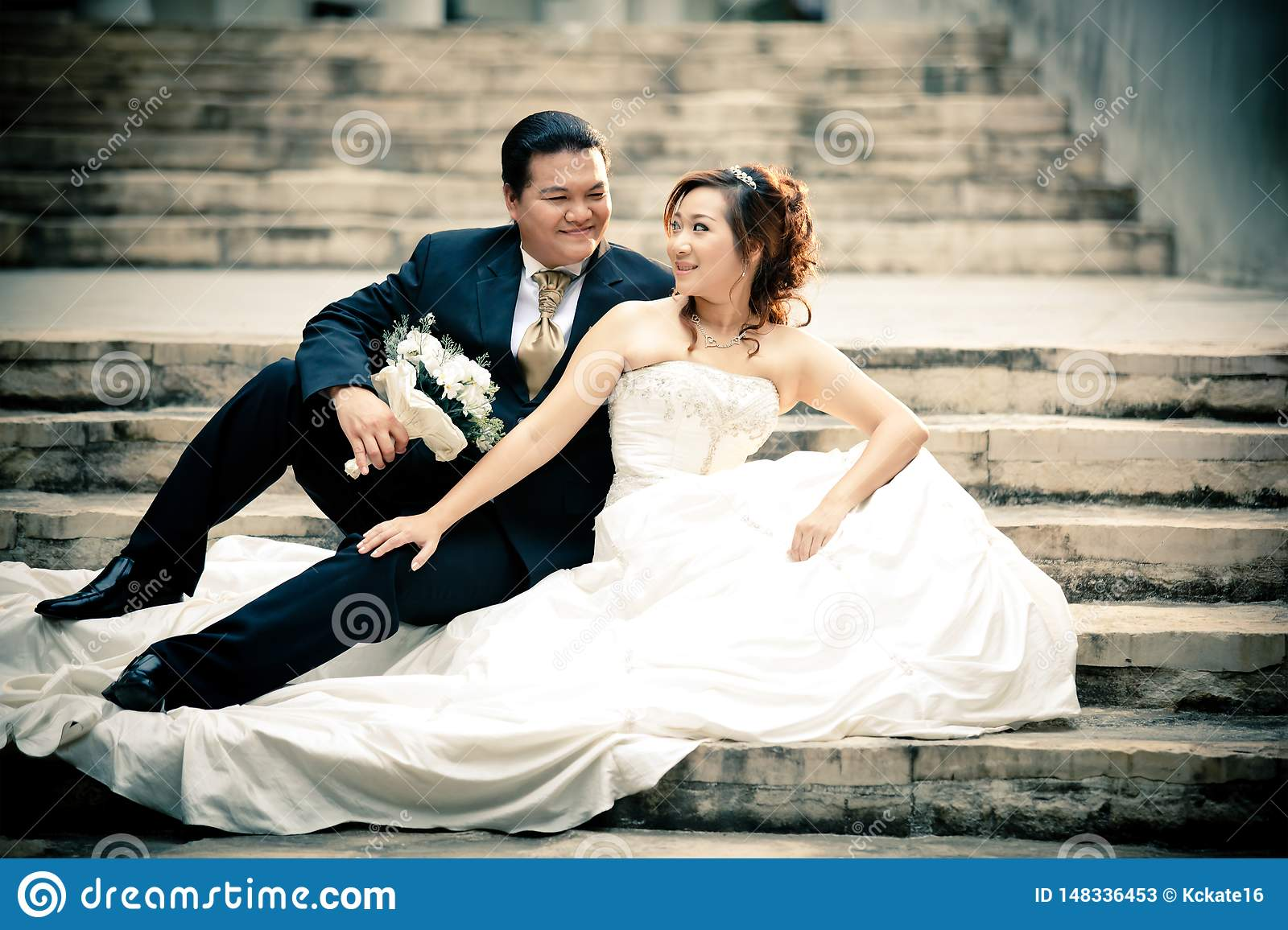Wedding couple enjoying romantic moments outsides on a summer. Happy bride and groom on their wedding.