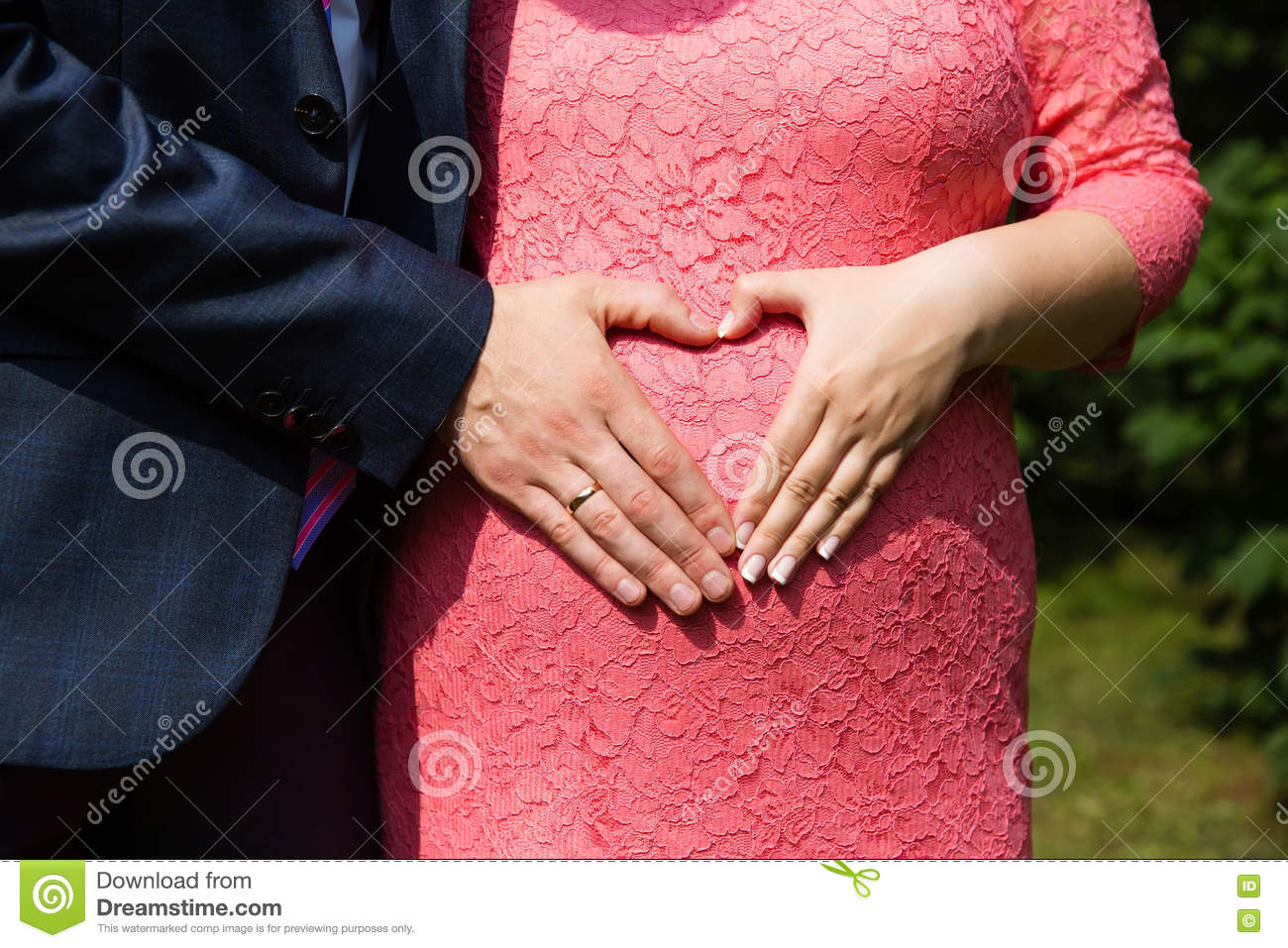 Wedding Couple Hands With Rings On Woman\'s Pregnant Belly Stock ...
