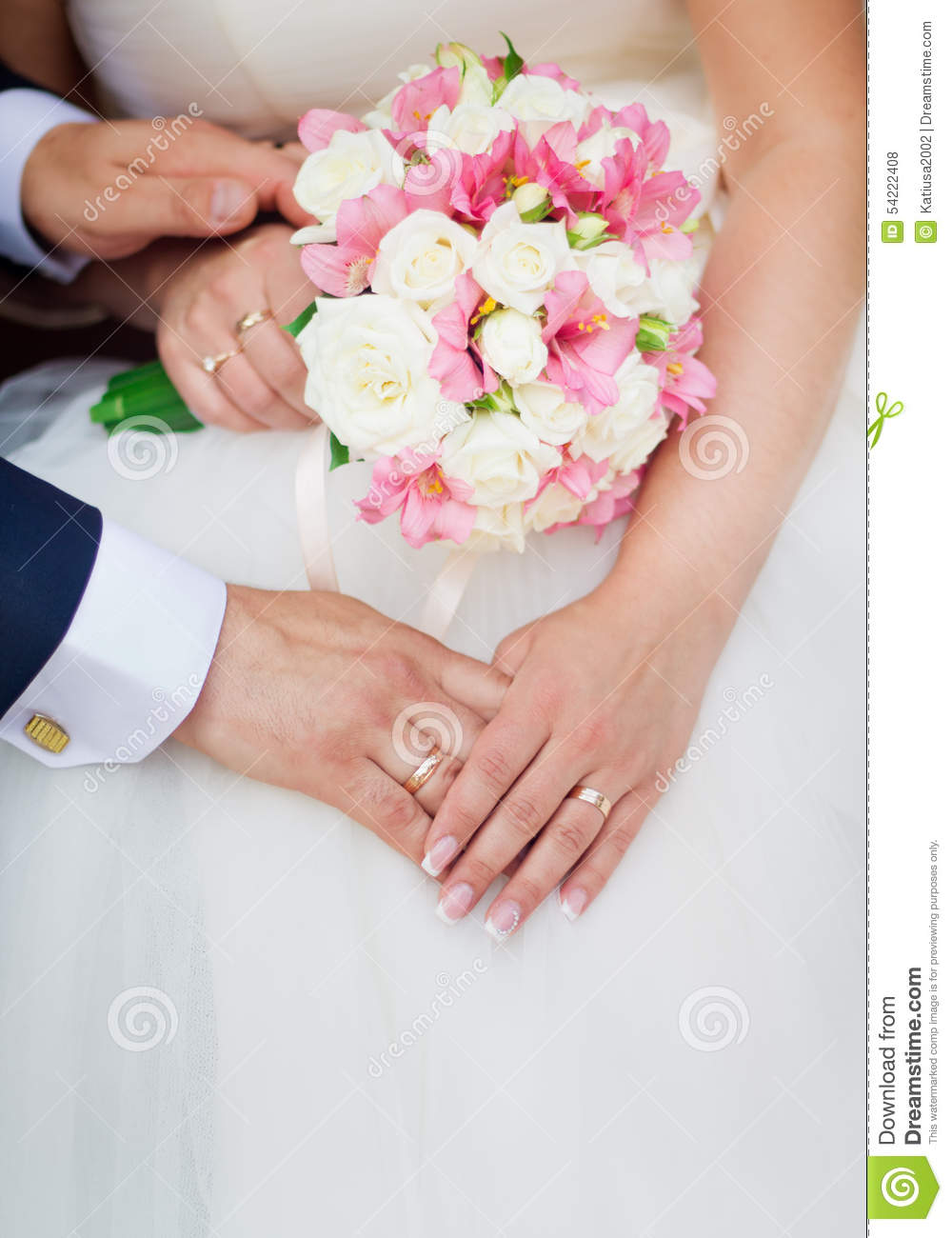 Wedding couple holding hands with a bouquet of flowers stock photo wedding couple holding hands with a bouquet of flowers izmirmasajfo Choice Image