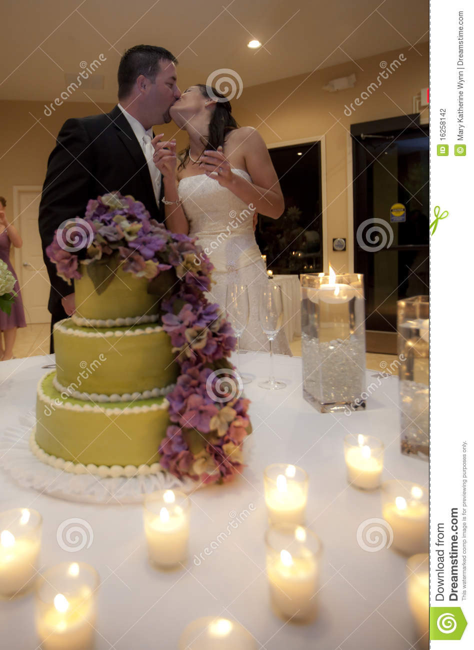 Wedding Couple Kissing By Cake Stock Photography Image