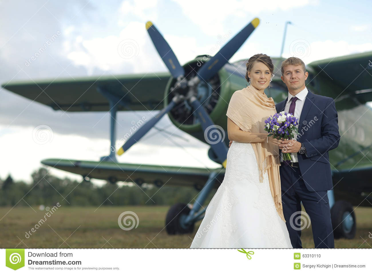 Wedding couple near vintage aircraft