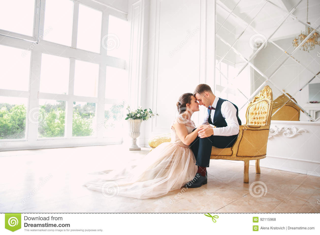Wedding couple on the studio. Wedding day. Happy young bride and groom on their wedding day. Wedding couple - new family.
