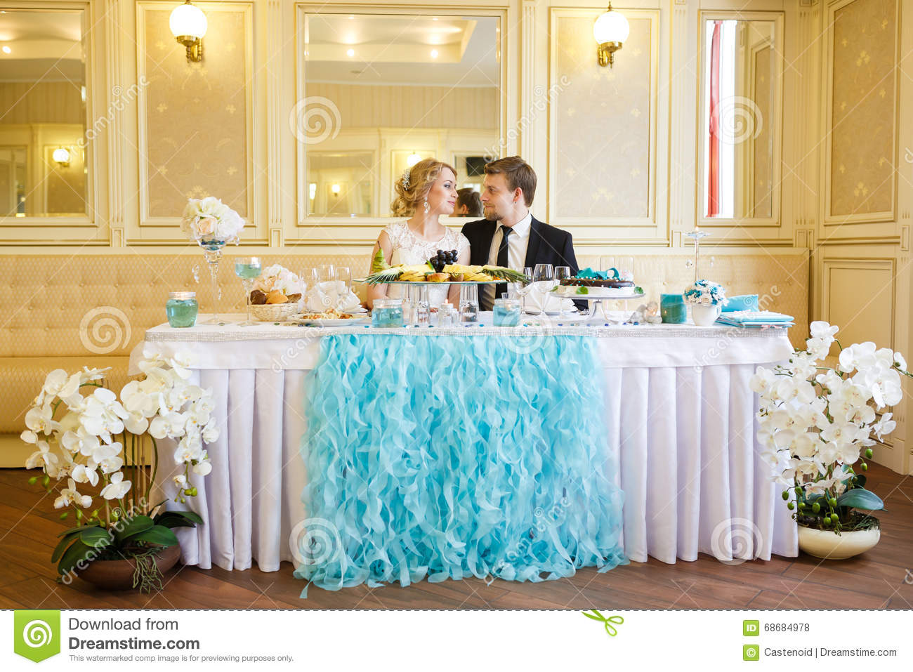 Wedding Couple At The Table Stock Photo