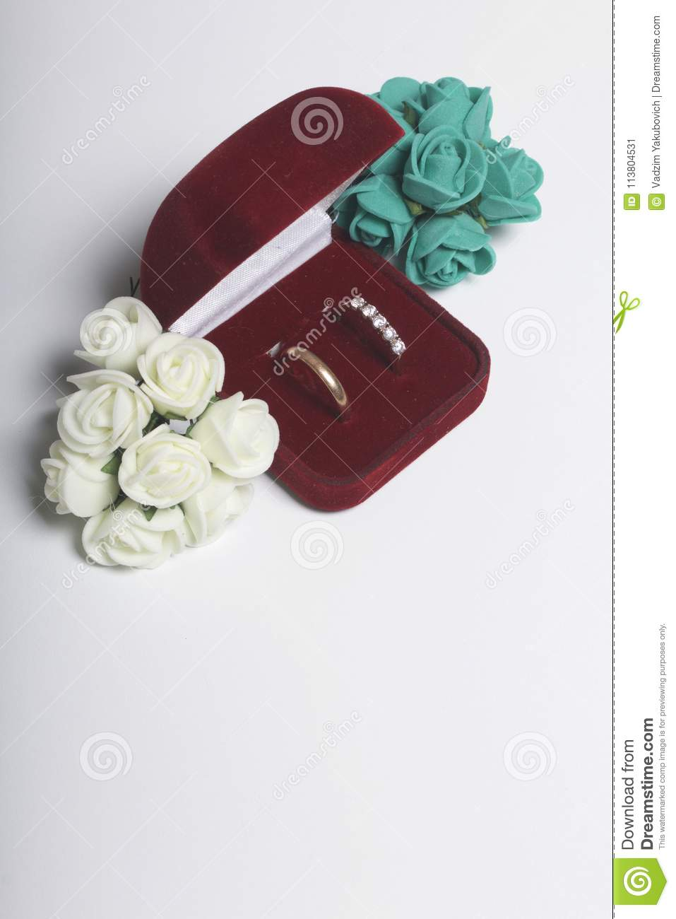 Wedding Decor. Bouquet Of Artificial Flowers And Wedding Rings In ...