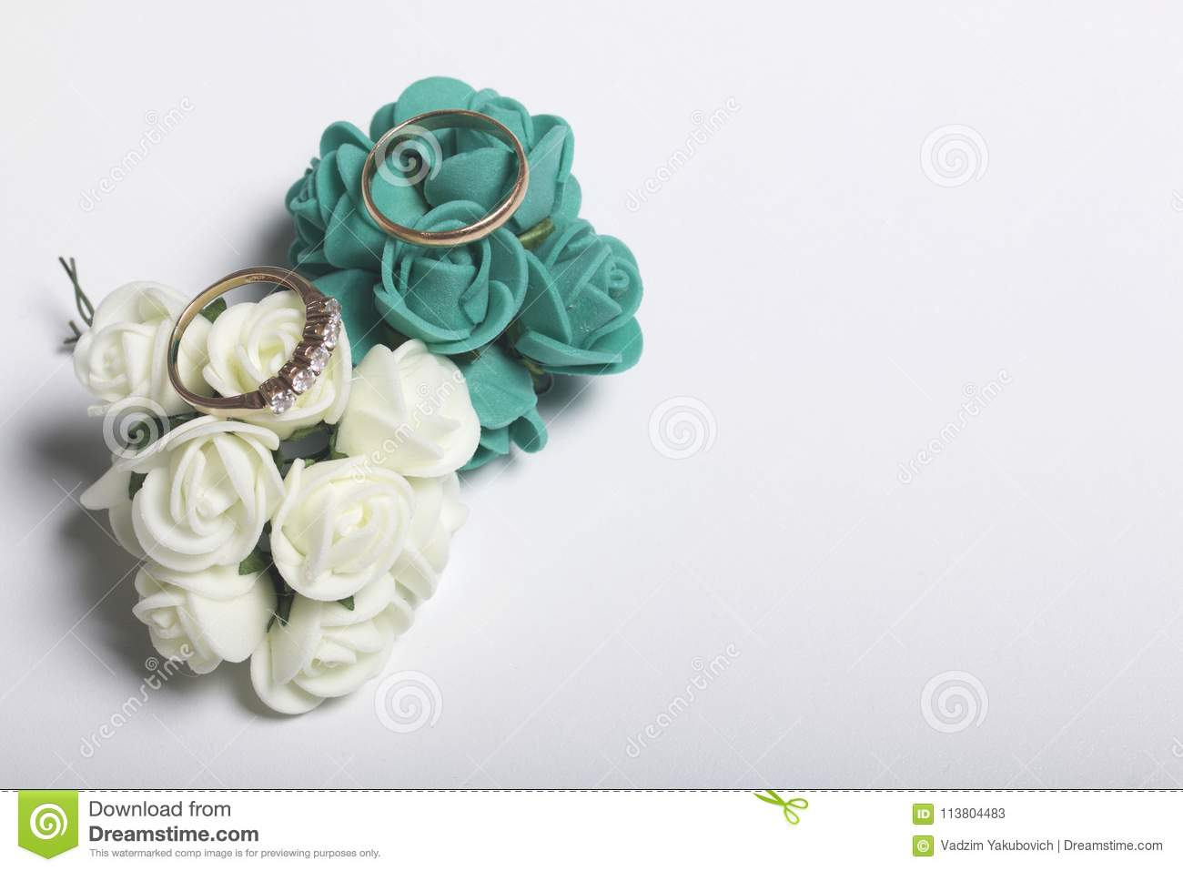 Wedding Decor. Bouquet Of Artificial Flowers And Wedding Rings Lie ...