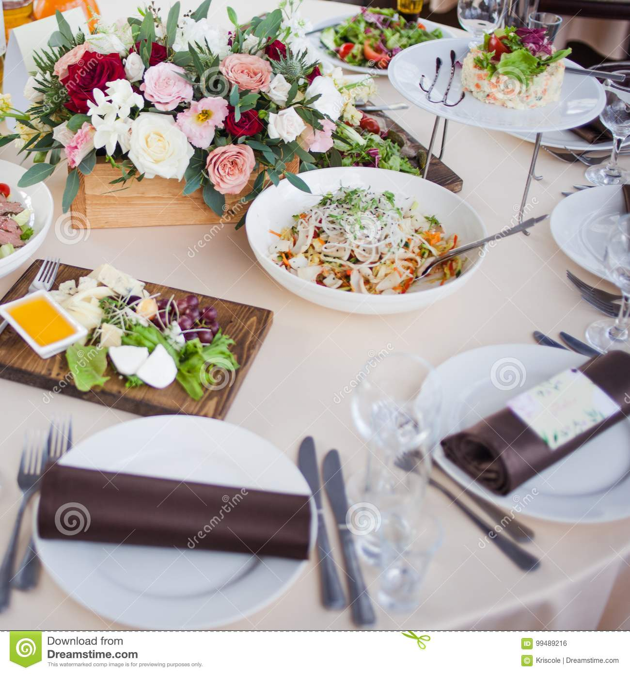 Wedding decor. Flowers in the restaurant, food on the table