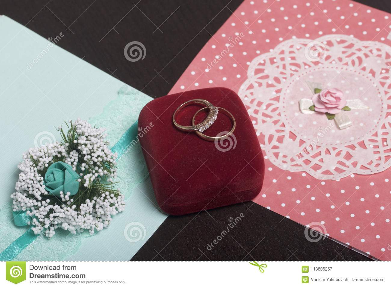 Wedding Decor. Invitation Cards And Wedding Rings In A Box, Lie On A ...