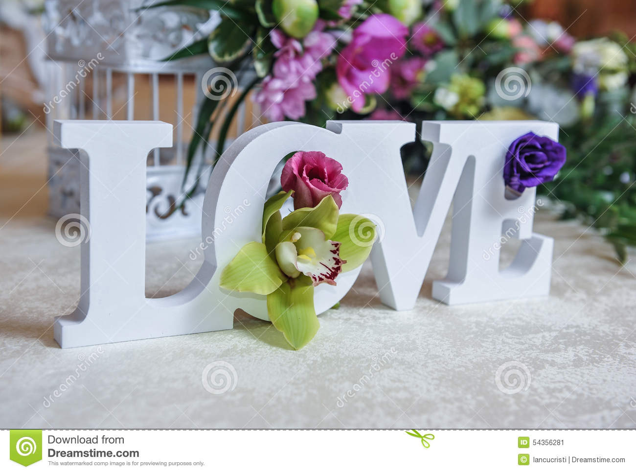 decor, LOVE letters and flowers on table. Fresh flowers and LOVE ...