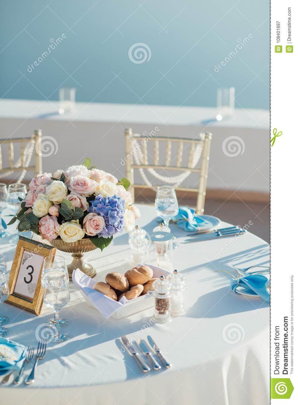 Wedding Decor Of Tables On The Island Of Santorini In Gold Blue And