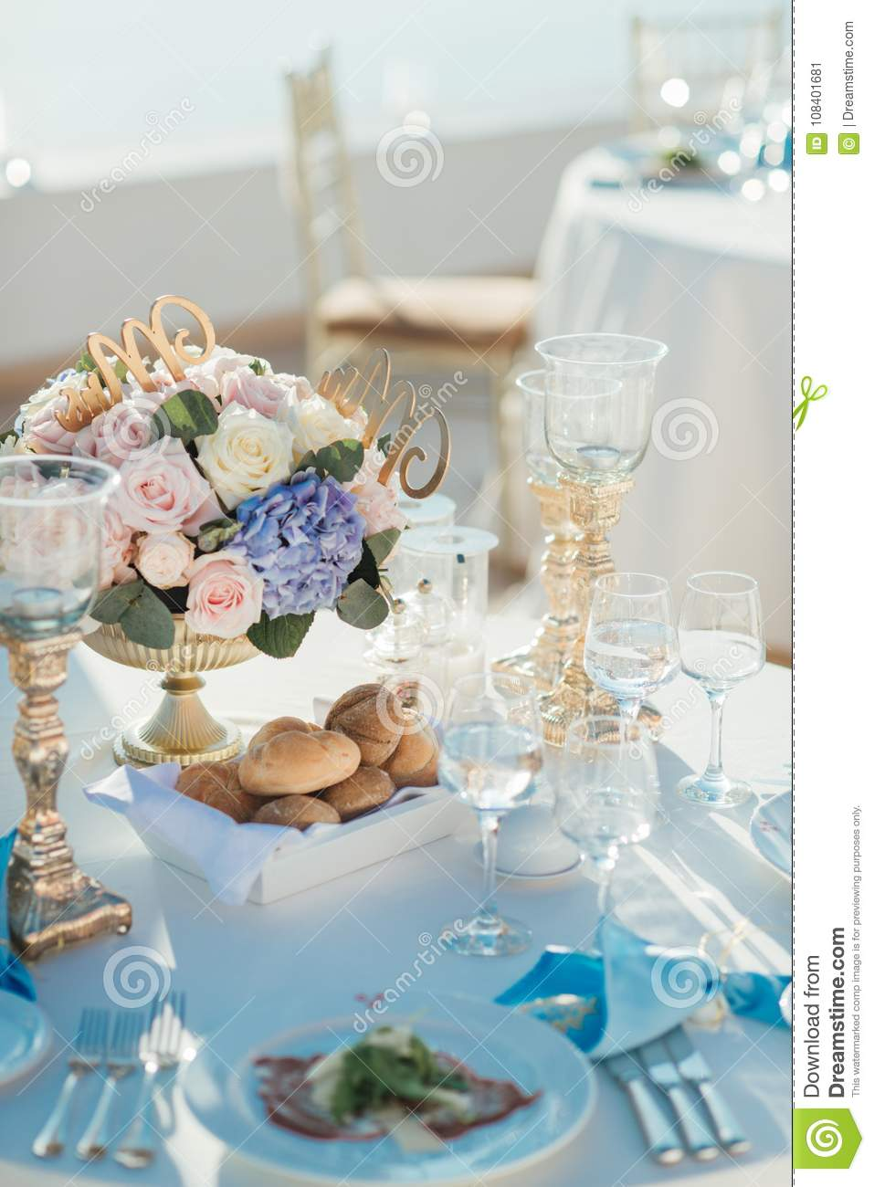 Wedding Decor Of Tables On The Island Of Santorini In Gold, Blue And ...