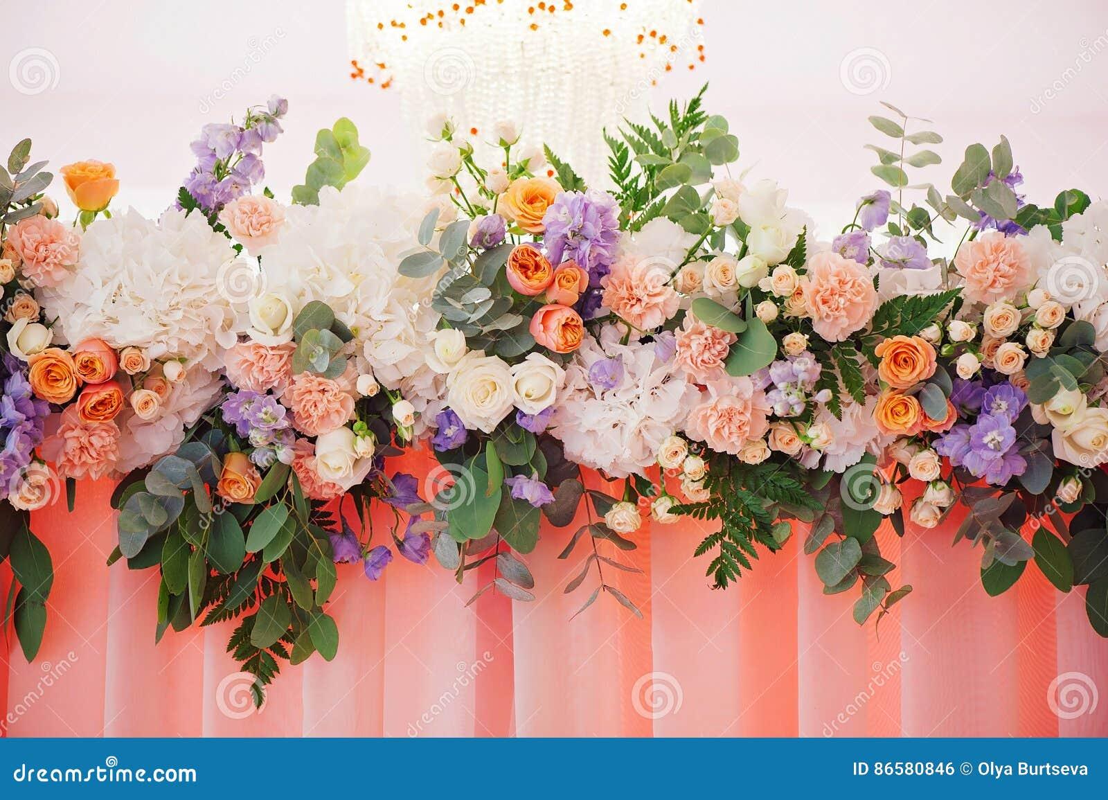 wedding decorating bouquet of roses and petals closeup stock photo