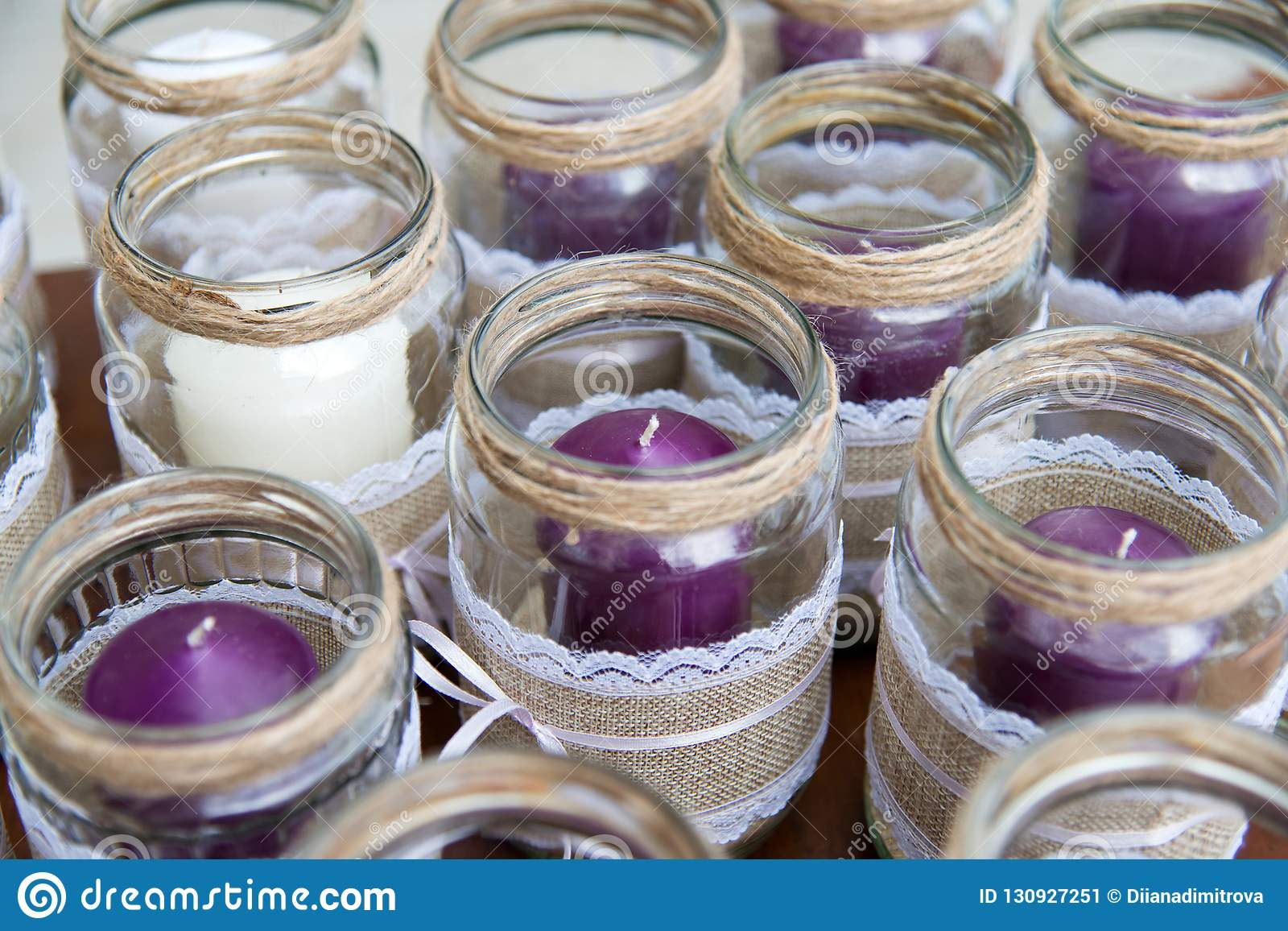 Wedding Decoration Candles In Glass Jars Decorated With Lace