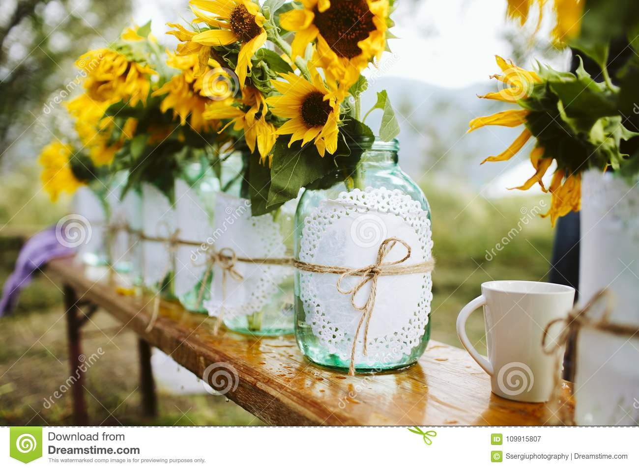 Wedding decoration details of sunflowers in mason jars stock image wedding decoration details of sunflowers in mason jars junglespirit Choice Image